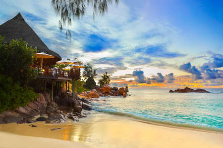 praslin: Cafe on tropical beach at sunset - nature background