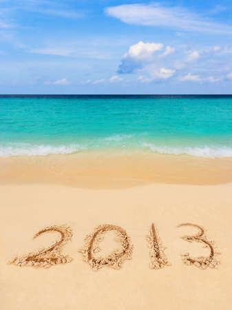 Numbers 2013 on beach - concept holiday background photo