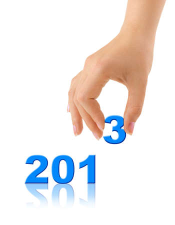 Numbers 2013 and hand isolated on white background photo