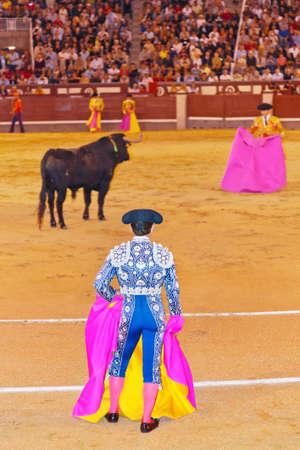 bull fight: Matador and bull in corrida at Madrid Spain Editorial