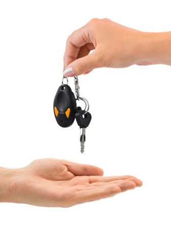 car keys: Hands and car key isolated on white background