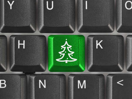 Computer keyboard with Christmas tree key - holiday concept Stock Photo - 16367504