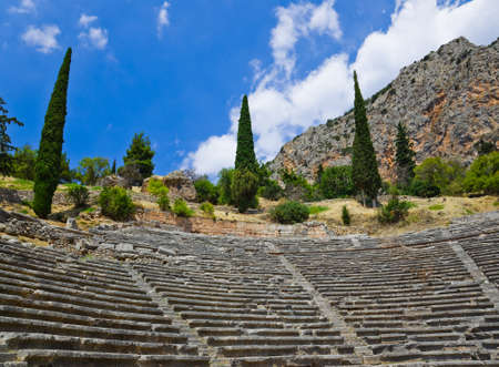 Ruins of amphitheater in Delphi, Greece - archaeology background photo