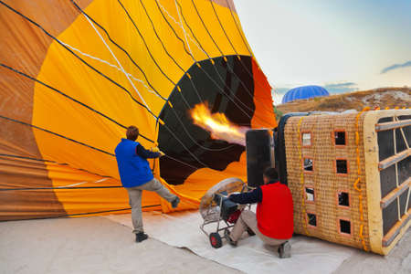 Hot air balloon and pilots in Cappadocia Turkey photo