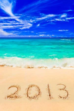 Zahlen 2013 am Strand - Konzept Urlaub Hintergrund Lizenzfreie Bilder