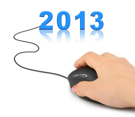 Hand with computer mouse and 2013 - new year concept photo