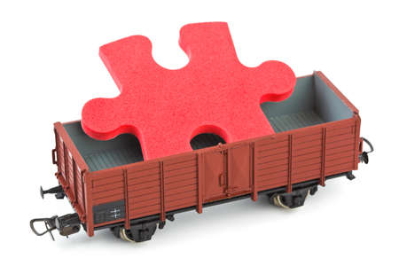 Toy train with puzzle isolated on white background photo