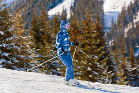 Skier at mountains ski resort Bad Gastein Austria - nature and sport background photo