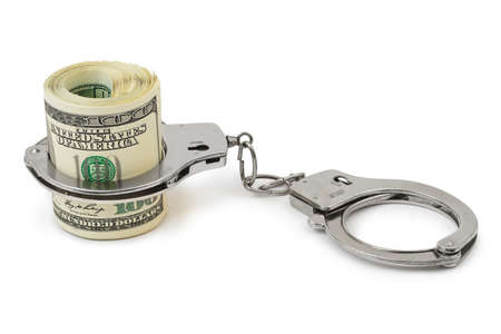 manacles: Money and handcuffs isolated on white background