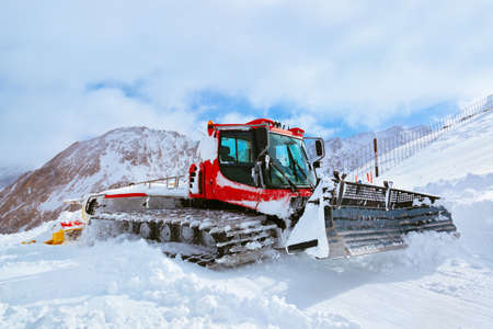 groomer: Machine for skiing slope preparations at Kaprun Austria - technology and sport background Stock Photo
