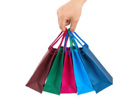 Hand with shopping bags isolated on white background Stock Photo - 17872175