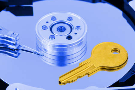 Key on computer harddrive - security concept background photo