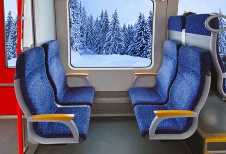 seating: Interior of train and winter forest - travel background