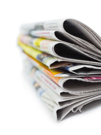 press media: Stack of newspapers isolated on white background