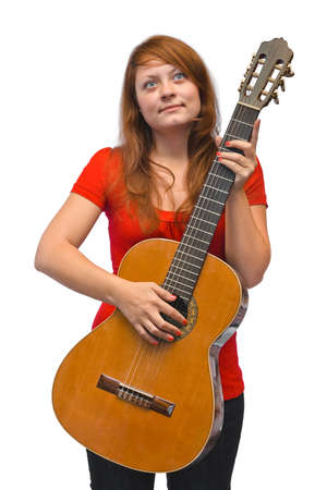 Young woman and guitar isolated on white background photo