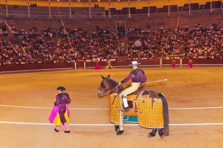 capote: Matadors in bullfighting arena at Madrid Spain
