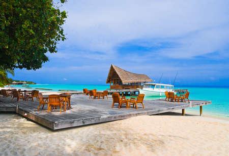 caribbean food: Cafe on the beach, ocean and sky Editorial