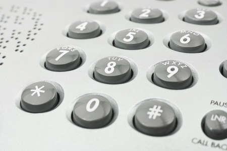 dialing: Macro of phone keypad - business background Stock Photo