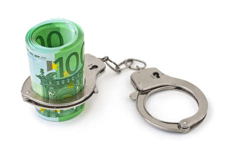 Money and handcuffs isolated on white background photo