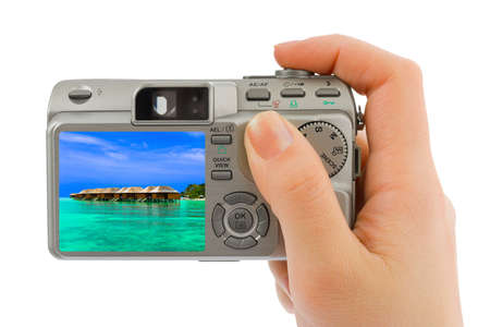 Hand with camera and landscape  my photo  isolated on white background photo
