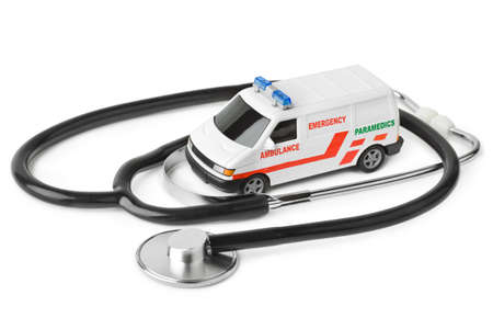 Stethoscope and toy ambulance car isolated on white background