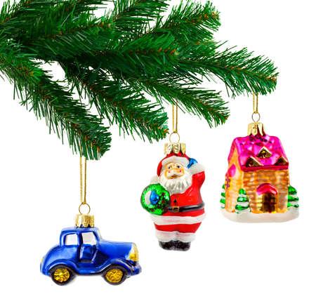 クリスマス ツリーと白で隔離されるおもちゃ 写真素材