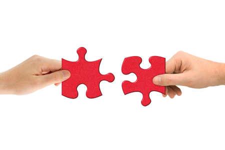 手と白い背景で隔離のパズル