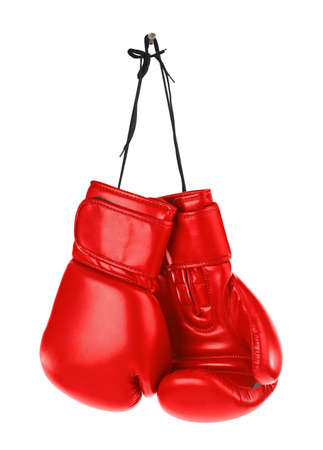 Hanging boxing gloves isolated on white background Фото со стока