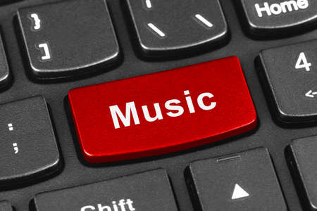 Computer notebook keyboard with Music key - technology  Stock Photo