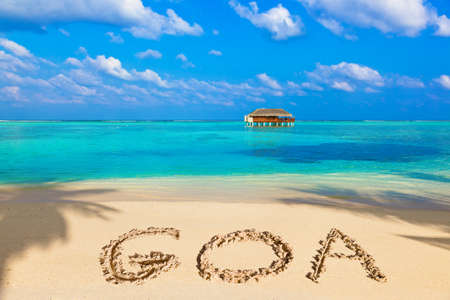 Word Goa on beach - concept holiday background Stock Photo - 45642876
