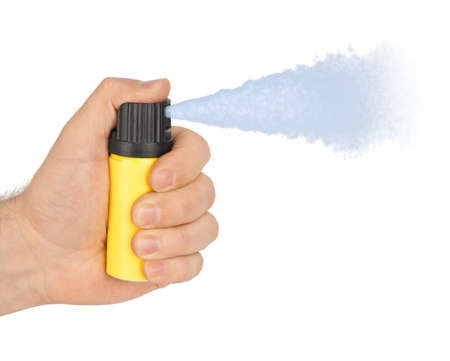 Hand with bottle of pepper spray isolated on white background Standard-Bild