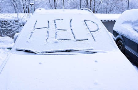 Word help on snow covered car - winter transportation problems Stock Photo