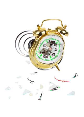 Broken alarm clock isolated on white background