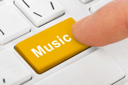 Computer notebook keyboard with Music key - technology background