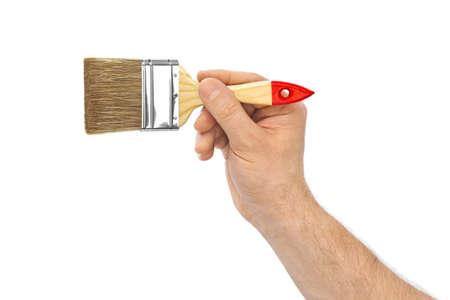 Main avec pinceau isolé sur fond blanc
