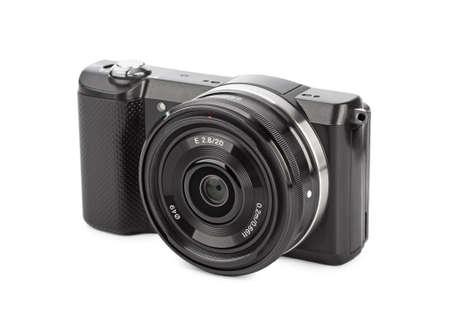 Mirrorless fotocamera die op een witte achtergrond Stockfoto
