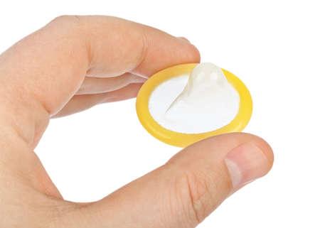 흰 배경에 고립 된 손에 콘돔 스톡 콘텐츠