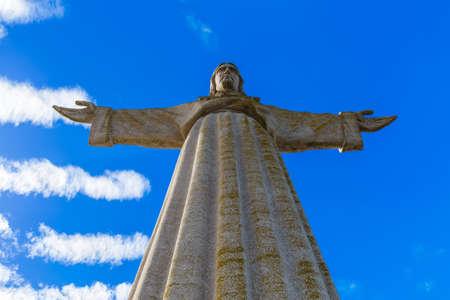 The Cristo Rei monument of Jesus Christ - Lisbon Portugal - architecture background
