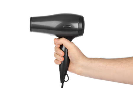 Hair dryer in hand isolated on white background
