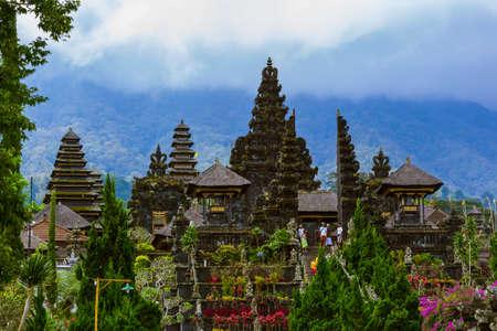 BALI INDONESIA - APRIL 26: People in Pura Besakih Temple on April 26, 2016 in Bali Island, Indonesia.