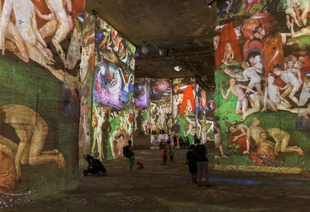 Provence, France - August 04, 2017: People are watching the Art Show Carrieres de Lumieres.