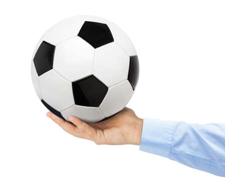 Hand and soccer ball isolated on white background