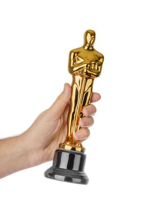 Hand with Award of Oscar ceremony isolated on white background Stockfoto