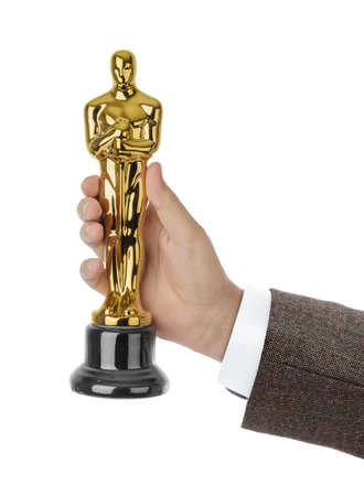 Hand with Award of ceremony isolated on white background