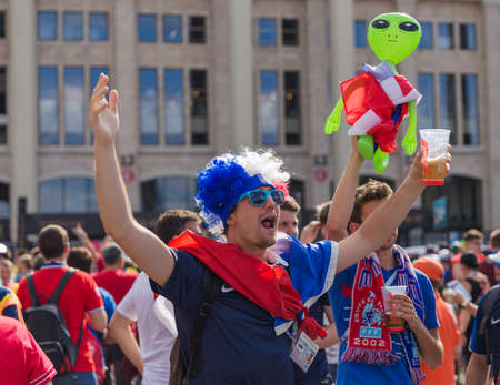 Moscow, Russia - June 26, 2018: Soccer fans on Moscow street during the 2018 Football World Cup in Russia.