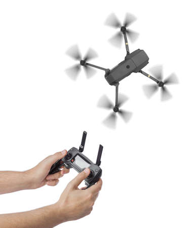 Drone and radio remote control in hands - isolated on white background Banque d'images