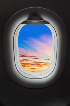 Sunset sky in airplane window - travel background