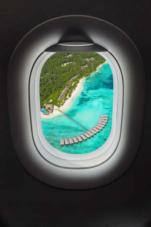 Tropical island at Maldives in airplane window - travel background Banque d'images