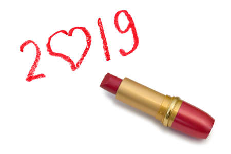 Lipstick and 2019 isolated on white background