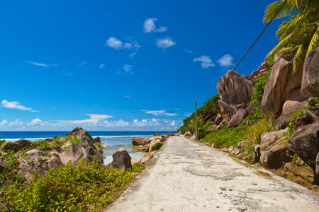 Road on tropical beach - Seychelles - nature background Banco de Imagens
